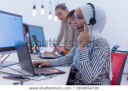 Beautiful business woman with headset. Call center. Customer sup Stock photo © dacasdo