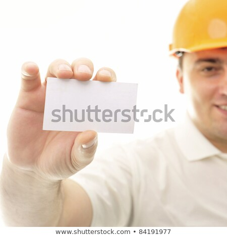 Closeup portrait of adult engineer man holding blank business ca Stock photo © HASLOO