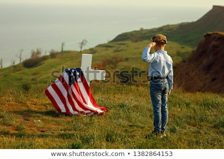 boy with salute Stock photo © Galyna