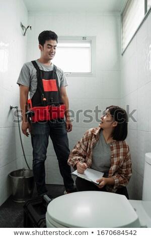 Iki tesisatçı çalışma tuvalet ev içmek Stok fotoğraf © photography33