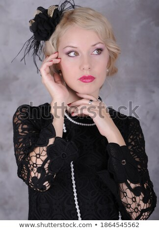 Beautiful retro stylized photo of a pretty woman Stock photo © nessokv