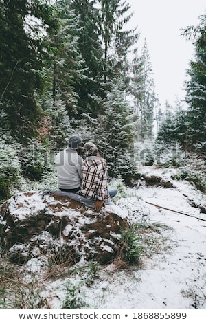a blonde woman watching lovingly a man in the forest Stock photo © photography33