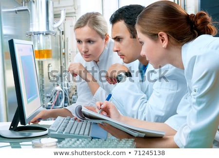 Three scientists in laboratory Stock photo © photography33
