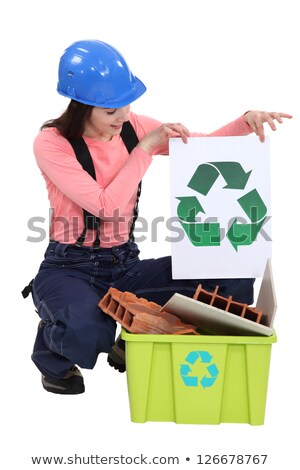 pretty female bricklayer holding recycling logo Stock photo © photography33