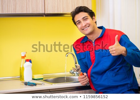 craftsman holding a spanner and thumbs up stock photo © photography33
