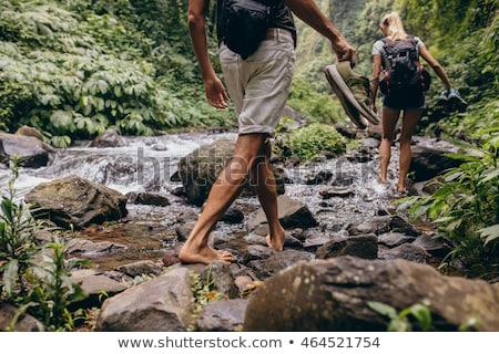 man in shotrs hiking stock photo © hofmeester
