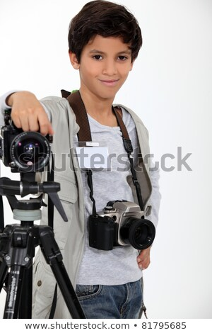 little boy acting like a professional photographer Stock photo © photography33