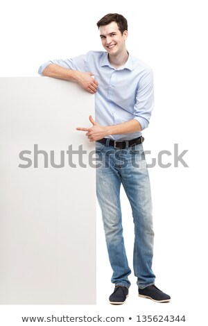 young guy pointing at the billboard full length shot stock photo © stockyimages