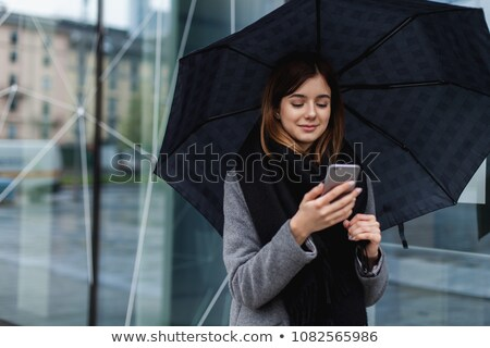 Nő esernyő esik az eső jókedv fantázia kép Stock fotó © tobkatrina