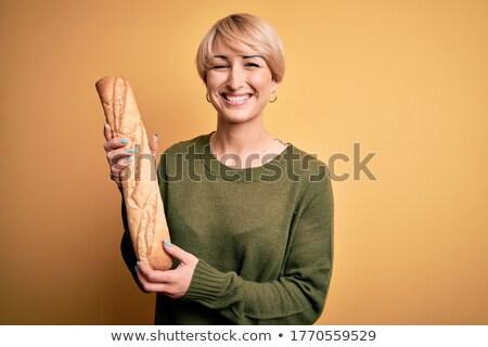 Delighted blond woman baking bread  Stock photo © wavebreak_media