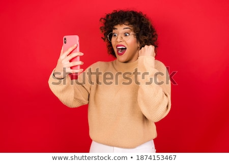 Portrait of a cute woman on the phone while standing against a white background stock photo © wavebreak_media