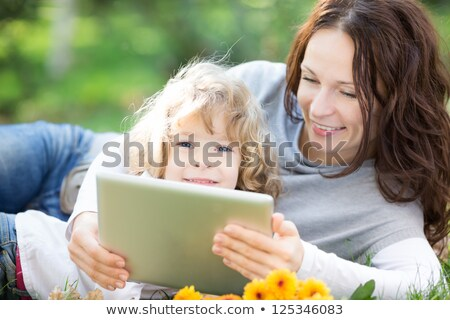 Portrait of a smiling boy using a tablet computer against a white background Stock photo © wavebreak_media