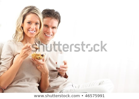 Couple eating breakfast on sofa Stock photo © photography33