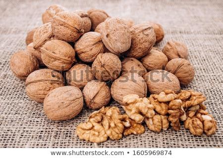 Mature walnuts on woven fabric Stock photo © maxpro