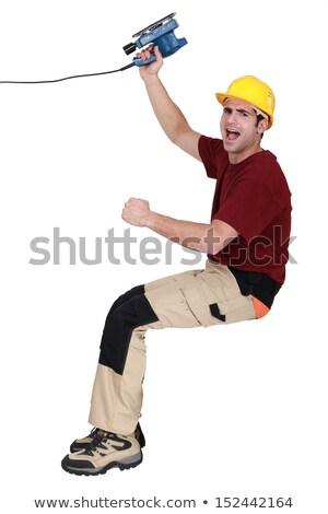 joyful carpenter holding sander machine Stock photo © photography33