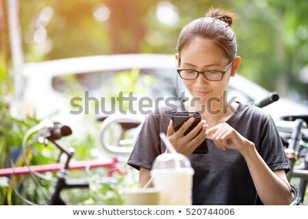 mopile phone with mandarine Stock photo © Discovod