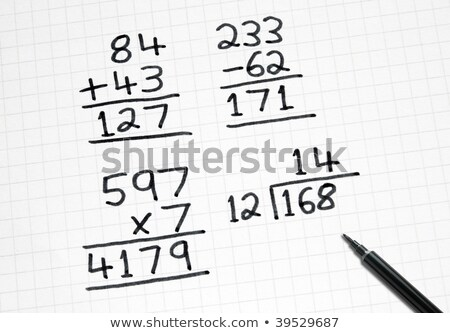 Writing simple maths sums on square paper. Stock photo © latent