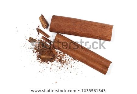 chocolate bars stack and cinnamon sticks stock photo © natika