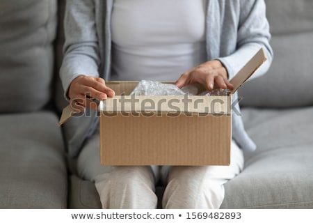 opening cardboard delivery parcel packaging box Stock photo © LoopAll