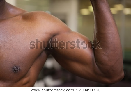 Close-up mid section of shirtless muscular man Stock photo © wavebreak_media