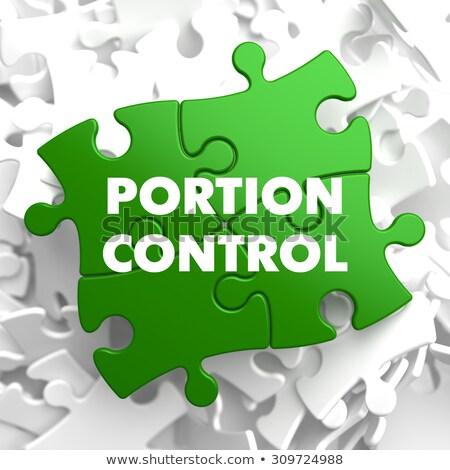 Portion Control on Green Puzzle. Stock photo © tashatuvango