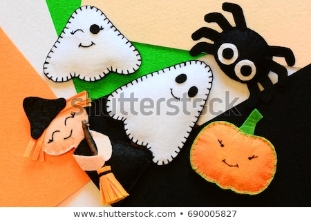 Kid greeting card concept. Felt doll on colorful background Stock photo © AndreyCherkasov