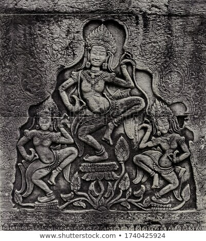 Historic Khmer bas-relief with dancing Hindu goddesses Stock photo © Mikko