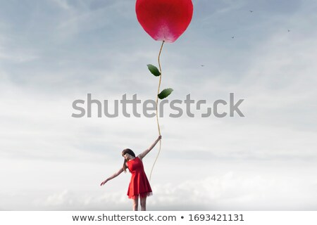 balloons fly in the sky. It symbolize positivity and happiness 