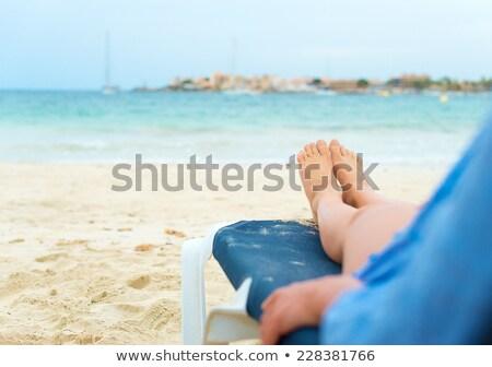 Lebarnult lábak fiatal nő napozás perem hideg Stock fotó © dash