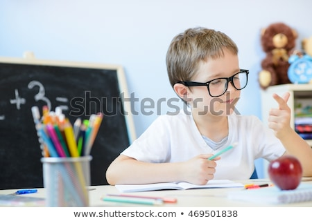 Boy counting and calculating on the desk Stock photo © bluering