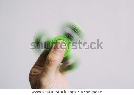 Fidget spinner spinning on white background Stock photo © elly_l