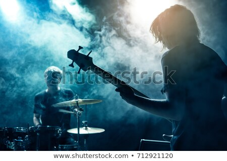 Guitarist playing guitar on stage Stock photo © wavebreak_media