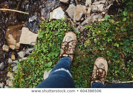 Legs of woman in tourist boots close-up. Hiking Stock photo © vlad_star