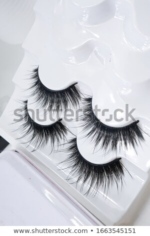 Artificial Eyelashes in White Holder. Stock photo © courtyardpix