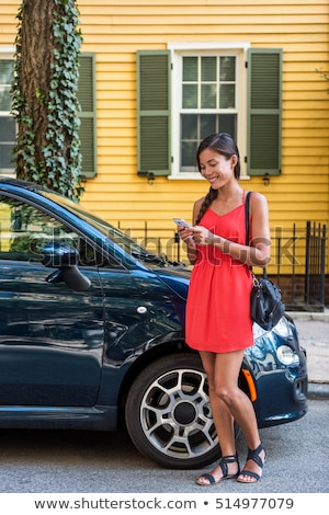 Stock photo: Woman in front of her house and car