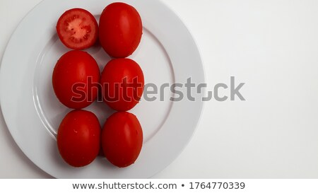 Six juicy tomatoes with drops of water Stock photo © digitalr