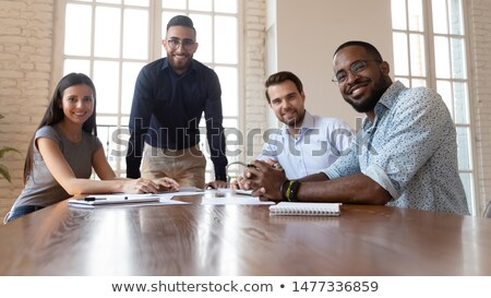 Four office workers look to camera Stock photo © IS2