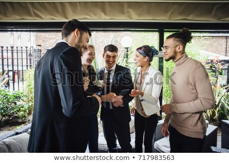 Business people standing in courtyard Stock photo © IS2