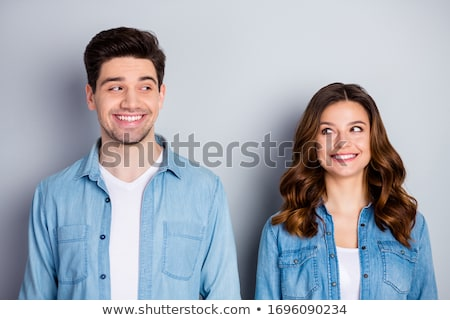 Photo of happy two friends man and woman in casual clothing sitt Stock photo © deandrobot