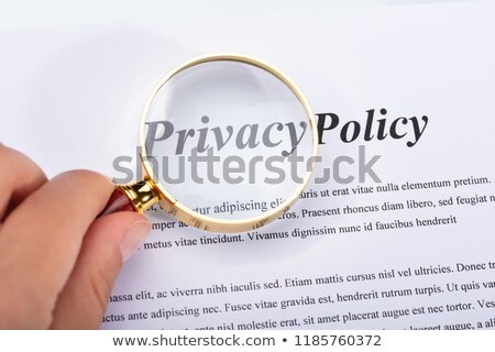 Woman Holding Magnifying Glass Over Privacy Policy Form Stock photo © AndreyPopov