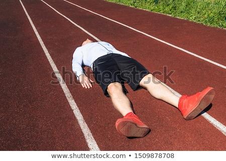 исчерпанный спортсмен законченный работает стадион лице Сток-фото © deandrobot