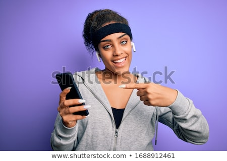Stock photo: woman with smartphone and earphones doing sports