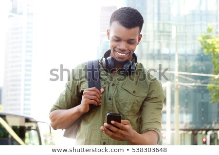 close up of man with backpack standing at wall stock photo © dolgachov
