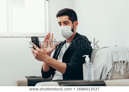 man with bottle of alcohol calling on smartphone stock photo © dolgachov