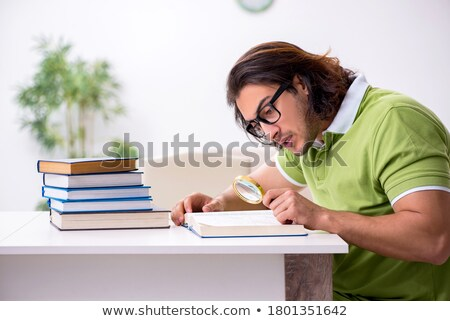 boy with magnifier reading book at home Stock photo © dolgachov