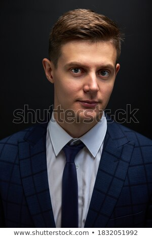 Vonzó jómódú férfi hivatalos ruházat irodaház Stock fotó © vkstudio