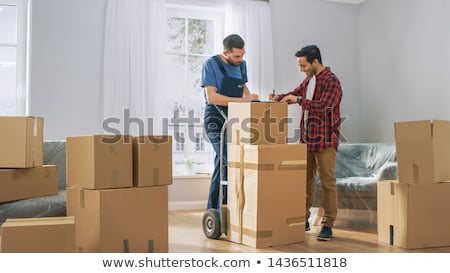 Loaders Unpacking Goods and Furniture in House Stock photo © robuart