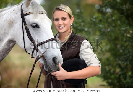 Blond female horse rider Stock photo © photography33