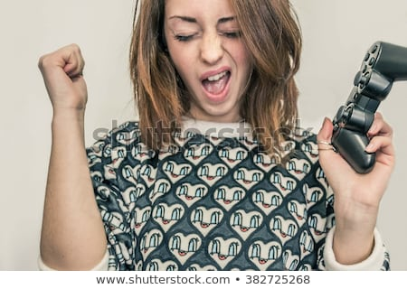 portrait of a young woman with video game stock photo © photography33