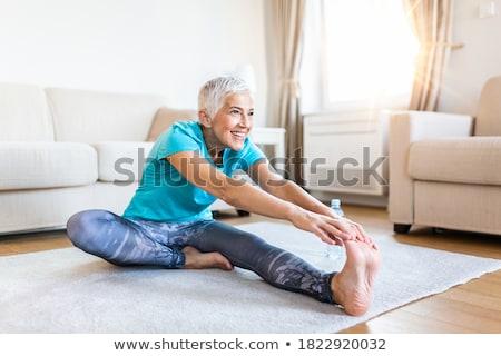 senior woman doing fitness exercises stock photo © photography33